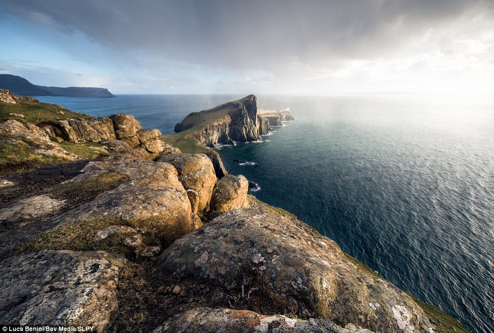 Where worlds collide: Supplied by Luca Benini, this sublime photograph shows rain over Nest Point, Skye, which is famed for its remarkable vistas. This image also teases an obscured skyline of the Outer Hebrides