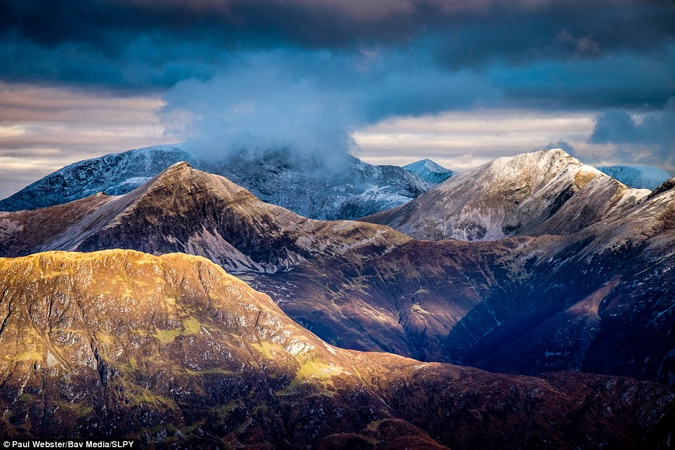 Victory image: Part of overall winner Paul Webster's submission, this image - The Mamores - depicts the light and shade and illuminating the Mamores ridge, with a mist-shrouded Ben Nevis behind...