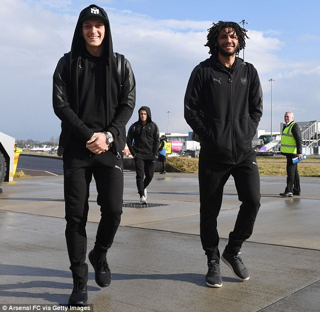 (L-R) Mesut Ozil and Mohamed Elneny were all smiles but a tense atmosphere in Milan awaits