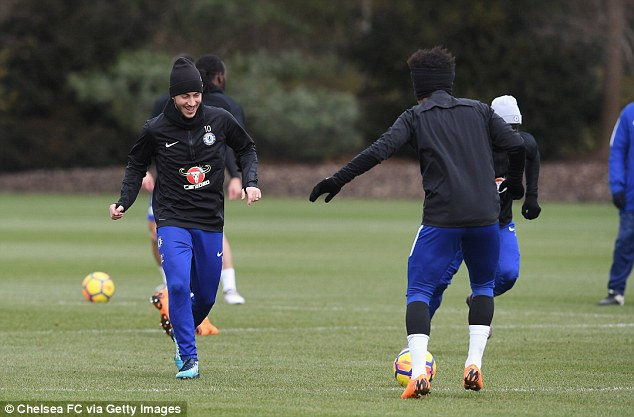 Chelsea star Eden Hazard (left) looked happy in training at the club's Cobham HQ on Friday