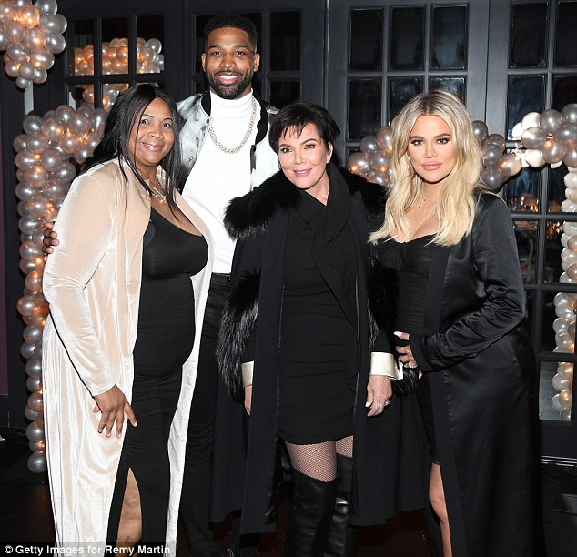 Thigh's the limit! Super-mom Kris Jenner took influence from her daughter's style, donning thigh-high boots and a short mini-dress