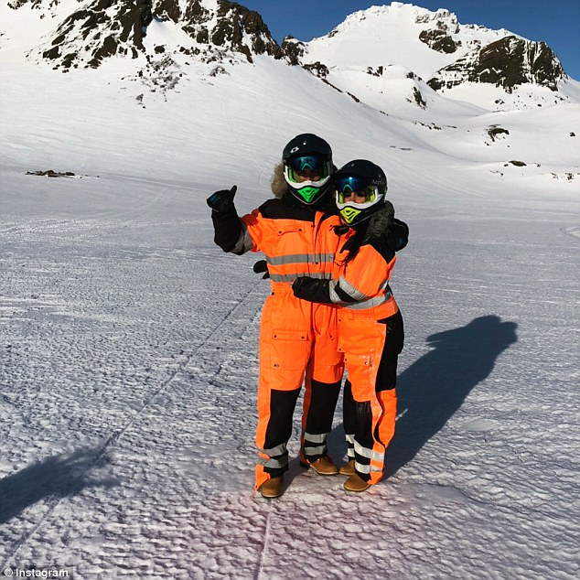 Cristiano Ronaldo (left) and Georgina Rodriguez get padded up for a snowmobile adventure