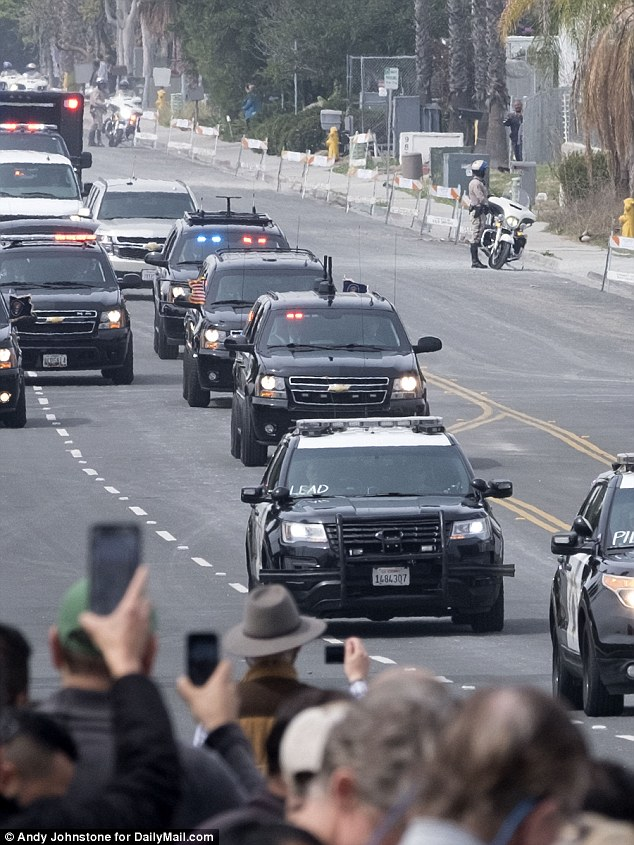 President Trump's motorcade is seen heading to the area where the president would inspect several prototype walls to be used to construct his long-promised border wall with Mexico