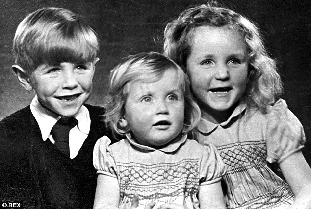 Stephen Hawking (left) is pictured as a child with his sisters Mary and Phillipa