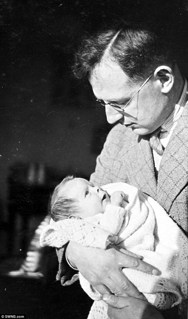 Stephen Hawking as a baby with his father Dr Frank Hawking shortly after his birth in 1942