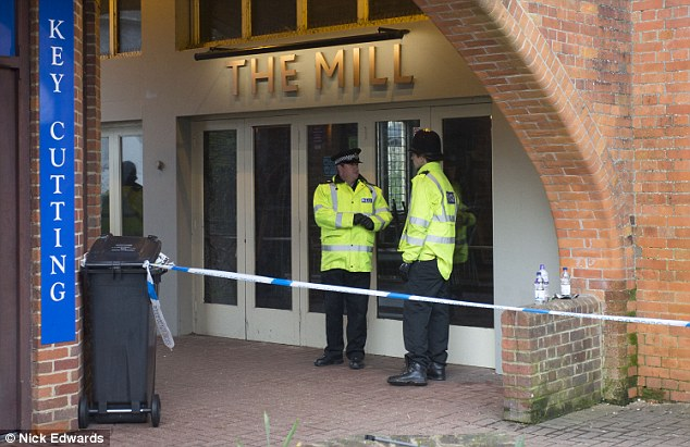 Officers guard The Mill pub where the pair had a drink before going to Zizzi. One theory was that their drinks were spiked, but this thesis was shortlived