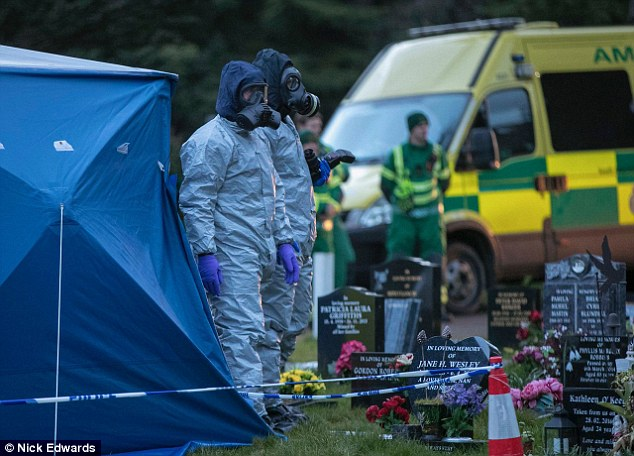 Investigators at Salisbury Cemetery where they dug up the grave of Sergei Skripal's wife. During this exercise, it was thought a bouquet of flowers were laced with the toxin, causing the former spy to be rendered unconscious