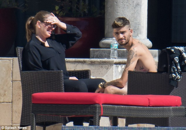 Close chats: While Zayn was shirtless, his gal pal opted for an all-black ensemble