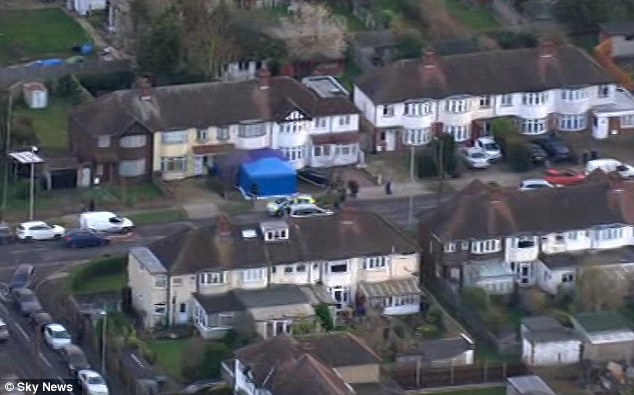 The blue-forensics tent is visible in the otherwise peaceful suburban streets of New Malden