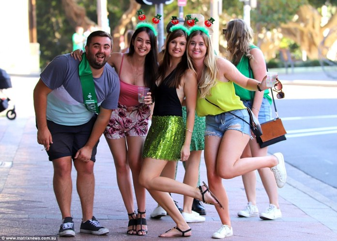 Lucky leprechauns: These three women wore leprechaun headbands while other donned green sashes and sequin skirts