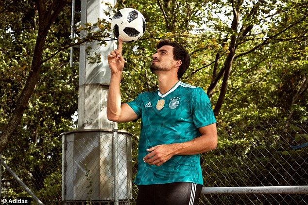 The new Germany away kit for the World Cup is modelled by Mats Hummels and takes inspiration from the green colours they wore during the 1990 World Cup semi-final
