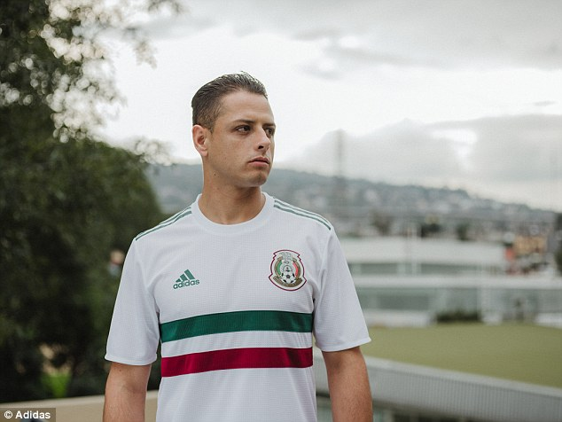 Javier Hernandez shows off the Mexico away kit, which is white with a red and green stripe