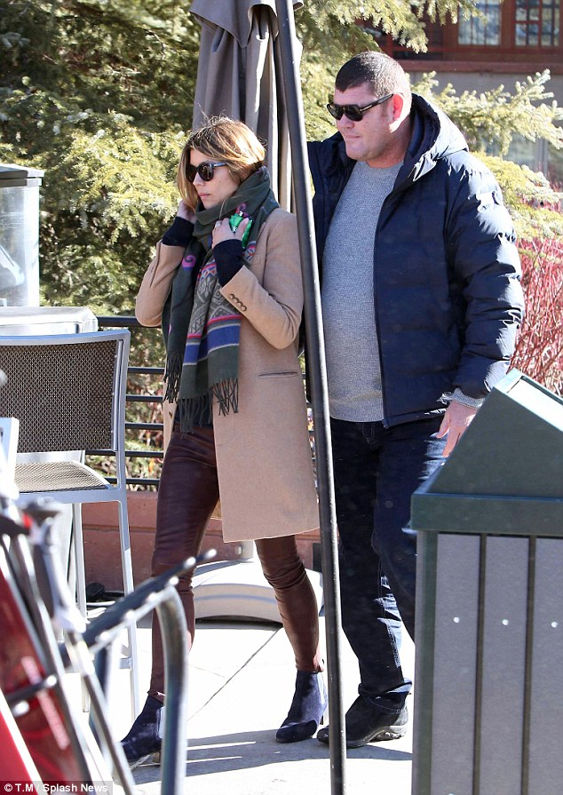 Pictured is James Packer with a mystery woman  Sky Resort in Aspen Colorado last year