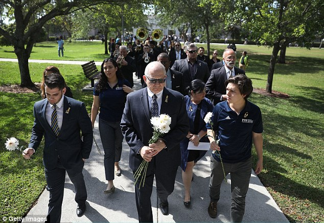 FIU President Mark  Rosenberg (pictured center) led the procession of mourners to the site