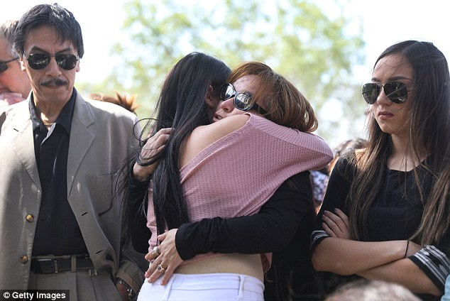 Duran's parents Orlando and Gina are pictured here with her sister Dina at a memorial held for her on Wednesday