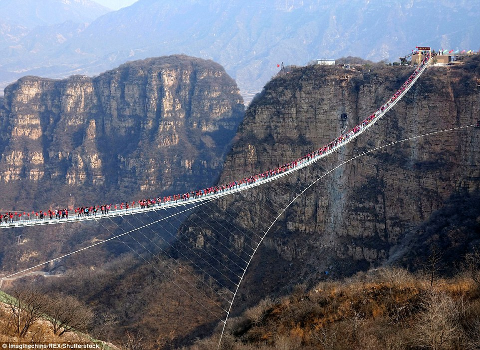Spectacular: The bridge in the Hongyagu Scenic Area, which hangs755 feet above the ground between two cliffs, roughly the height of a 66-storey building