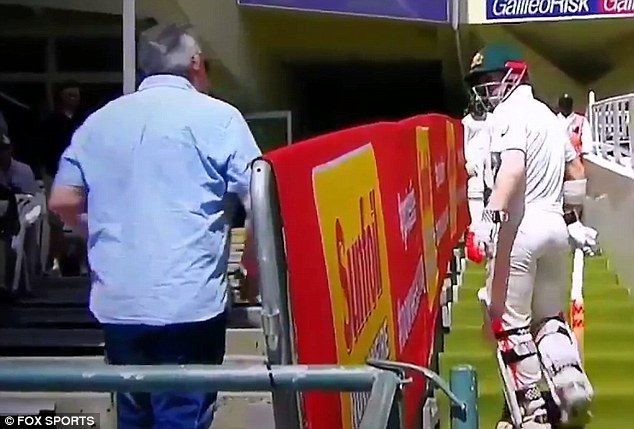 Warner was seen clashing with a male fan who appeared to be throwing insults at the batsman after he was bowled out during Friday's match against South Africa