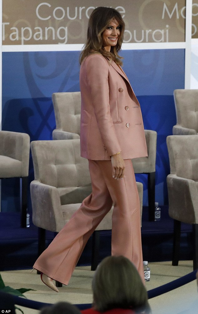 Cost of style: Melania's Emilio Pucci trousers and double-breasted blazer cost a total of $4,220