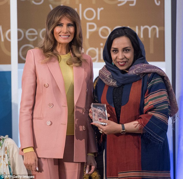Melania (pictured with Roya Sadat of Afghanistan) posed for photos with each of the honorees after she presented them with their awards
