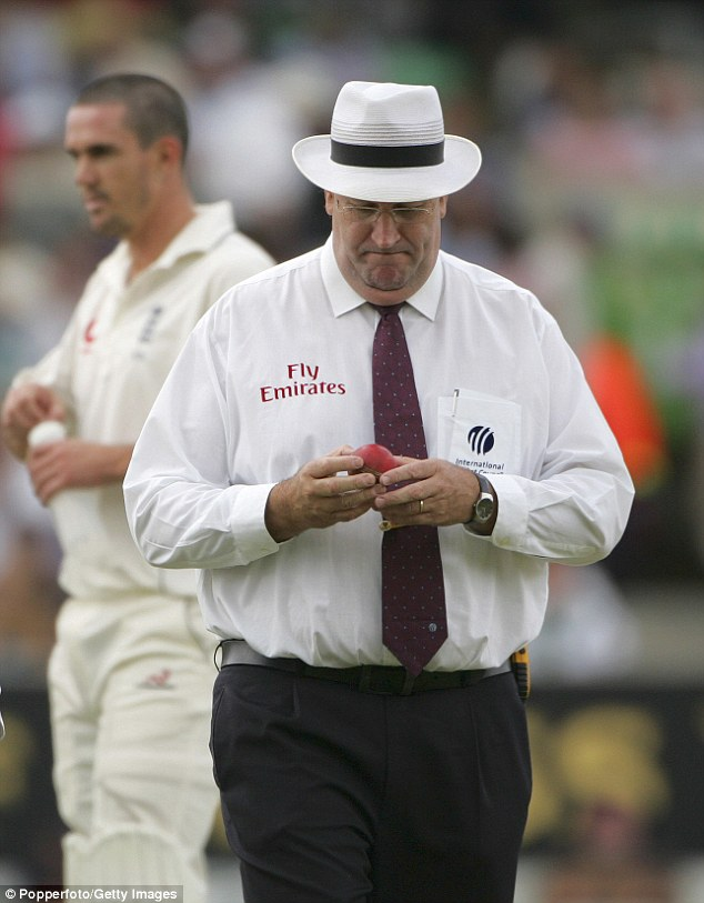 Darrell Hair inspects the ball during England's second innings in the match at The Oval in 2006