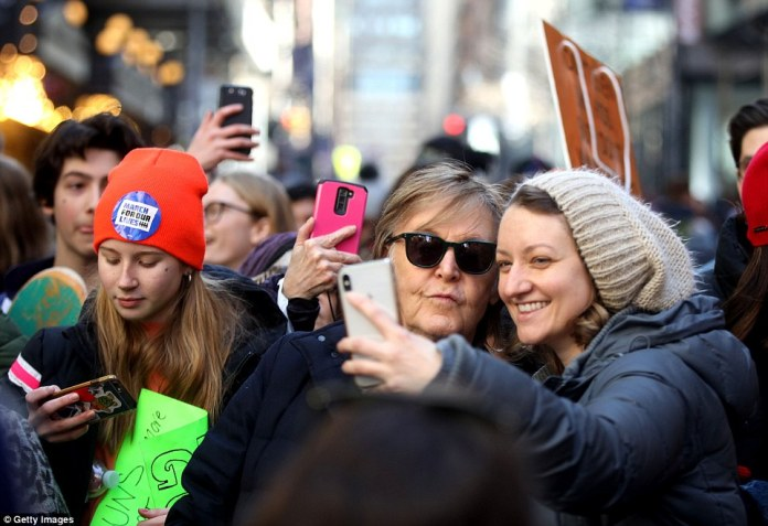 A woman takes a selfie with Paul McCartney during the March For Our Lives protest against gun violence in New York City