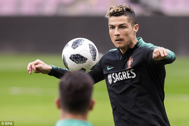 Ronaldo is focused on the ball as he gets ready to take on Ronald Koeman's Holland