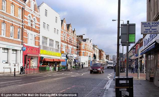 Police forced their way into a property on Tooting High Street (pictured) to discover the man stabbed to death
