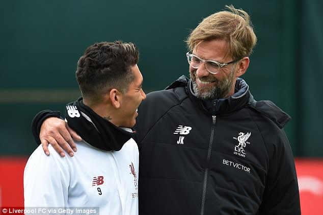 Klopp could be seen in conversation with Liverpool's deadly Brazilian striker Roberto Firmino
