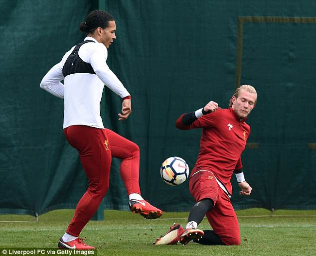 Virgil van Dijk lifts the ball over Loris Karius after he returned from international duty