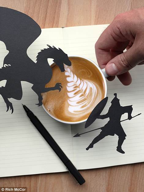 A coffee cup is transformed into a prop for a battle between a dragon and a warrior