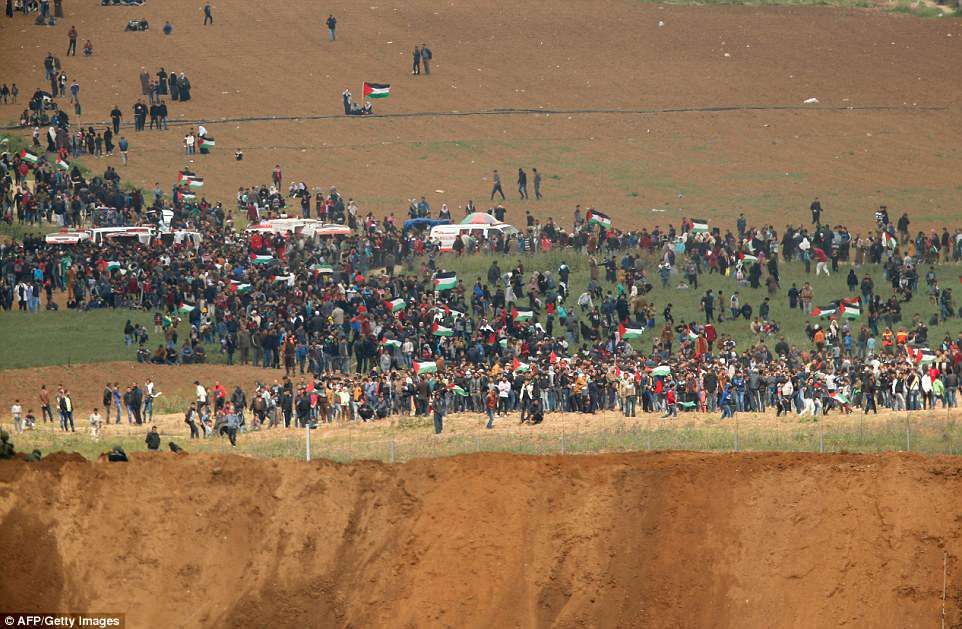 A picture taken  from the southern Israeli kibbutz of Nahal Oz across the border from the Gaza strip shows some of the participants in the  tent city protest commemorating Land Day