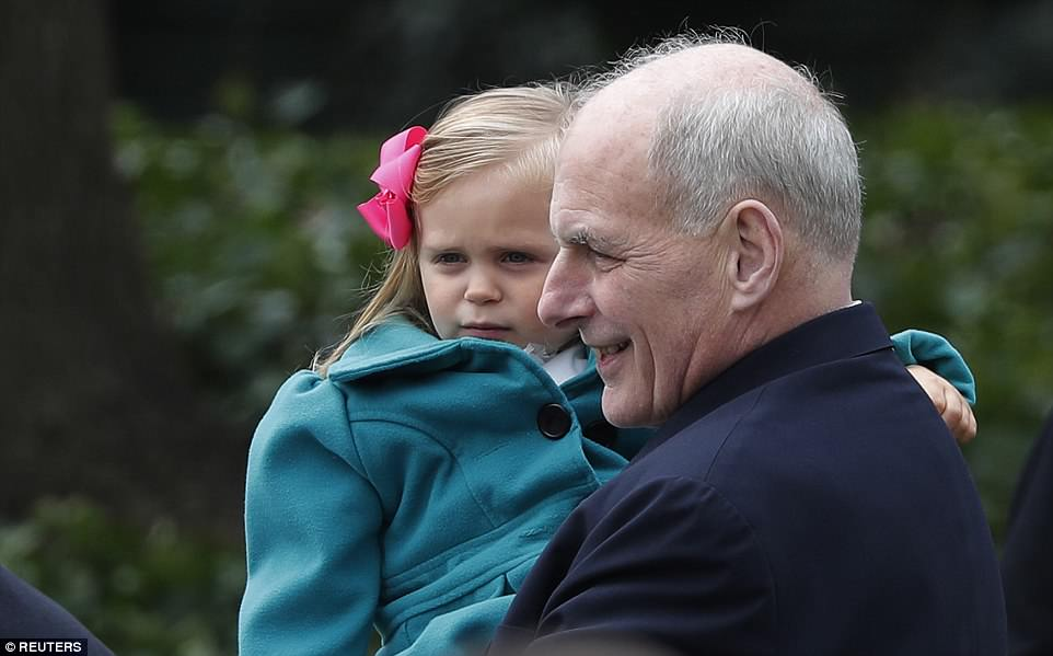 White House Chief of Staff John Kelly holds a young girl at Monday's White House Easter Egg Roll