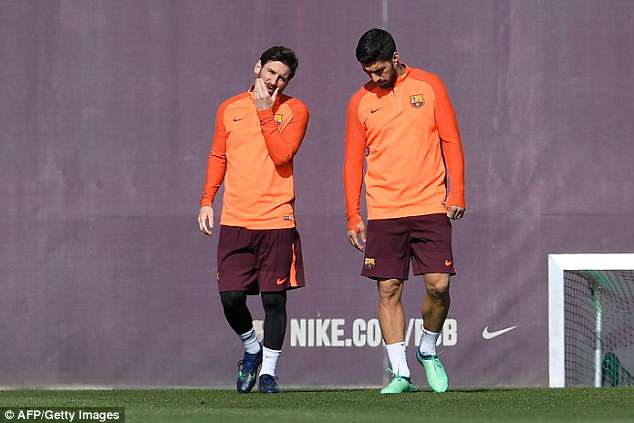 Lionel Messi (left) and Luis Suarez were pictured deep in conversation in training on Tuesday