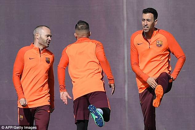 Andres Iniesta (left), Jordi Alba (centre) and Sergio Busquets were seen chatting in training