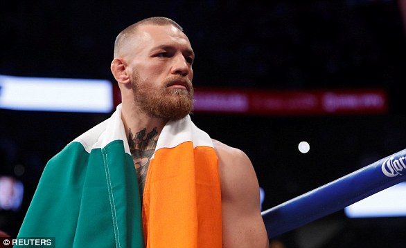 Conor McGregor makes his entrance before his fight with Floyd Mayweather Jr. in August 2017