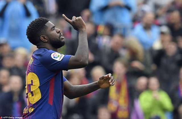 Defender Samuel Umtiti celebrates having doubled Barcelona's lead against Valencia early in the second half