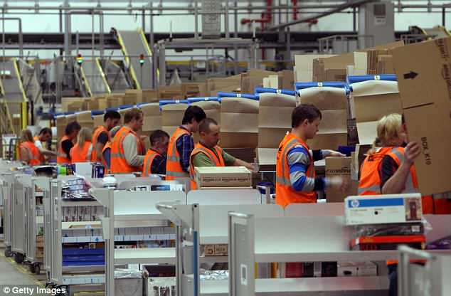 Amazon workers (pictured) are being replaced by robots as the company uses more robots and reduces their dependency on human resources, according to a Citi analyst. Amazon recruits only 100,000 people for Christmas, 20,000 less than in previous years