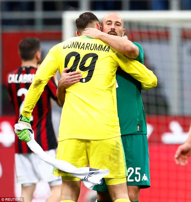 Donnarumma is embraced by Pepe Reina after making his 100th Serie A appearance for Milan