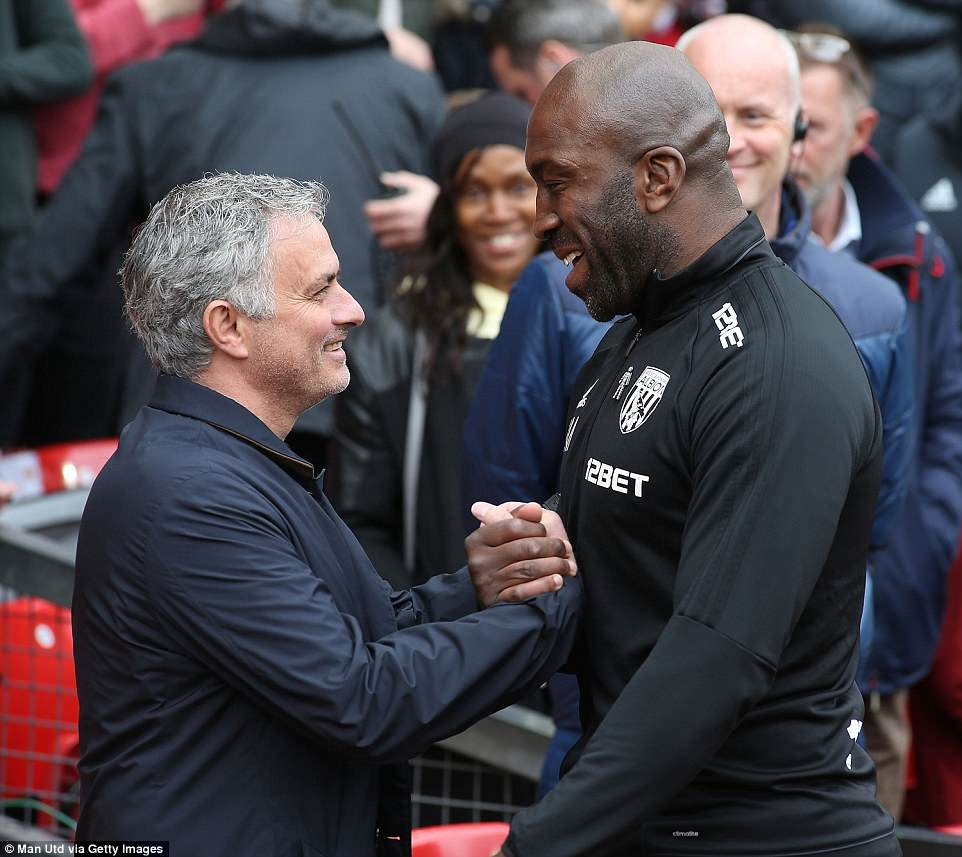 Jose Mourinho gives West Brom's caretaker manager Darren Moore a warm welcome to the Old Trafford touchline on Sunday