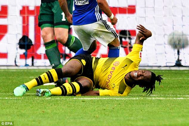 Belgium international Michy Batshuayi was taken off on a stretcher late on in Dortmund's loss