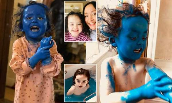 Toddler transforms herself into a smurf using bright blue ...