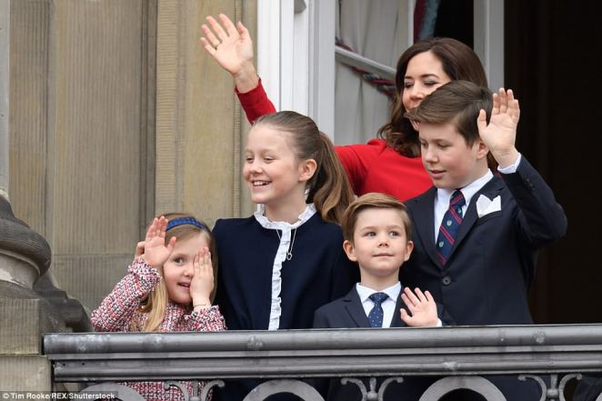 Playful Princess: Josephine, the daughter of Margrethe's son Crown Prince Frederik and his wife May, cheekily covered her eyes as her brothers and sister waved from the balcony