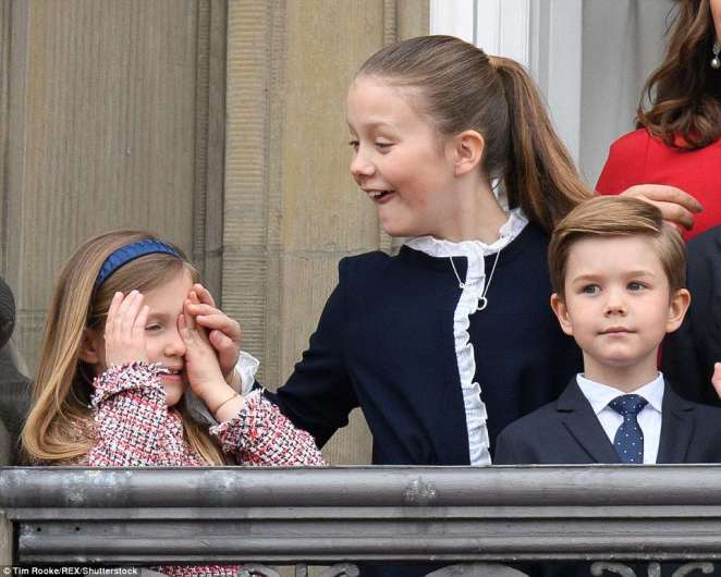 Spotting what her little sister was up to, a laughing Princess Isabella, 10, appeared to urge her to uncover her eyes