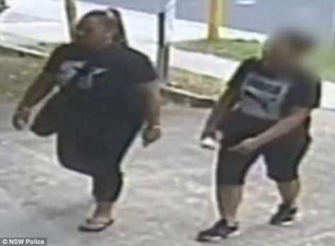 Officers believe the woman (left) with Analosa Ah Keniin the CCTV may hold vital information regarding the execution