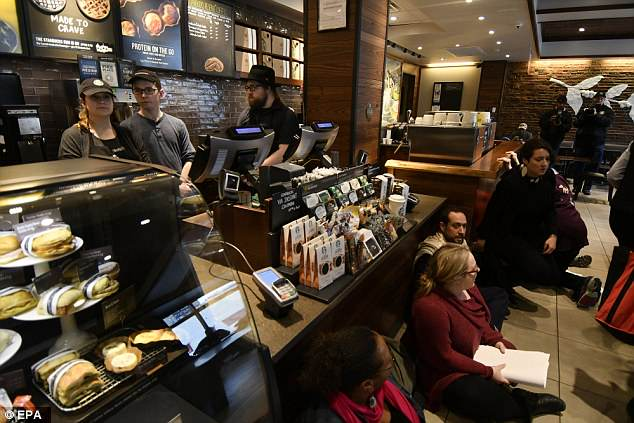 Members of POWER Interfaith movement stage a sit-in inside  Starbucks in protest over the incident