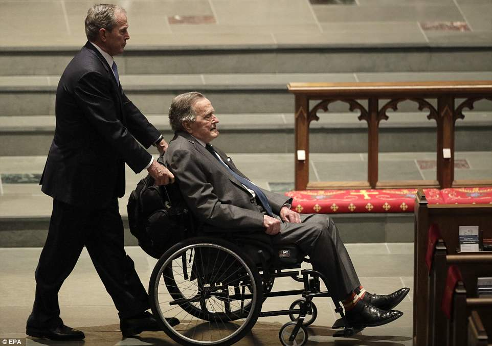Day of remembrance: Former president George W. Bush arrives at his wife's funeral service on Saturday with his son George H.W. Bush