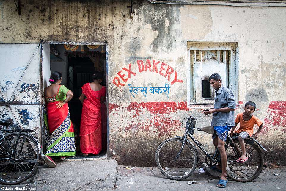British photographer Jade Nina Sarkhel won theFood for Sale prize for her image Rex Bakery - a bakery that has bullet holes in the wall. The bakery churns out 18,000 paos a day, operating 24/7 and selling bread through the keyhole counter overnight. Bread is given for free to those who can't afford it. Jade said: 'It's places like this that knit communities together in India'