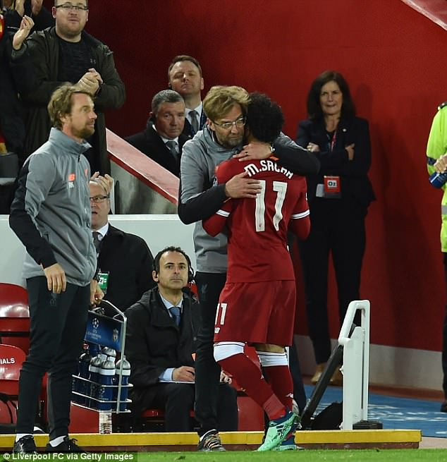 Salah, 25, is hugged by Reds boss Jurgen Klopp after being taken off during the second half