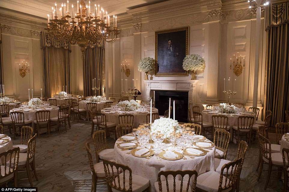 The first lady used china from two administrations - Bill Clinton's and George H.W. Bush's - to create a golden look for the tables, which glowed under the candlelight