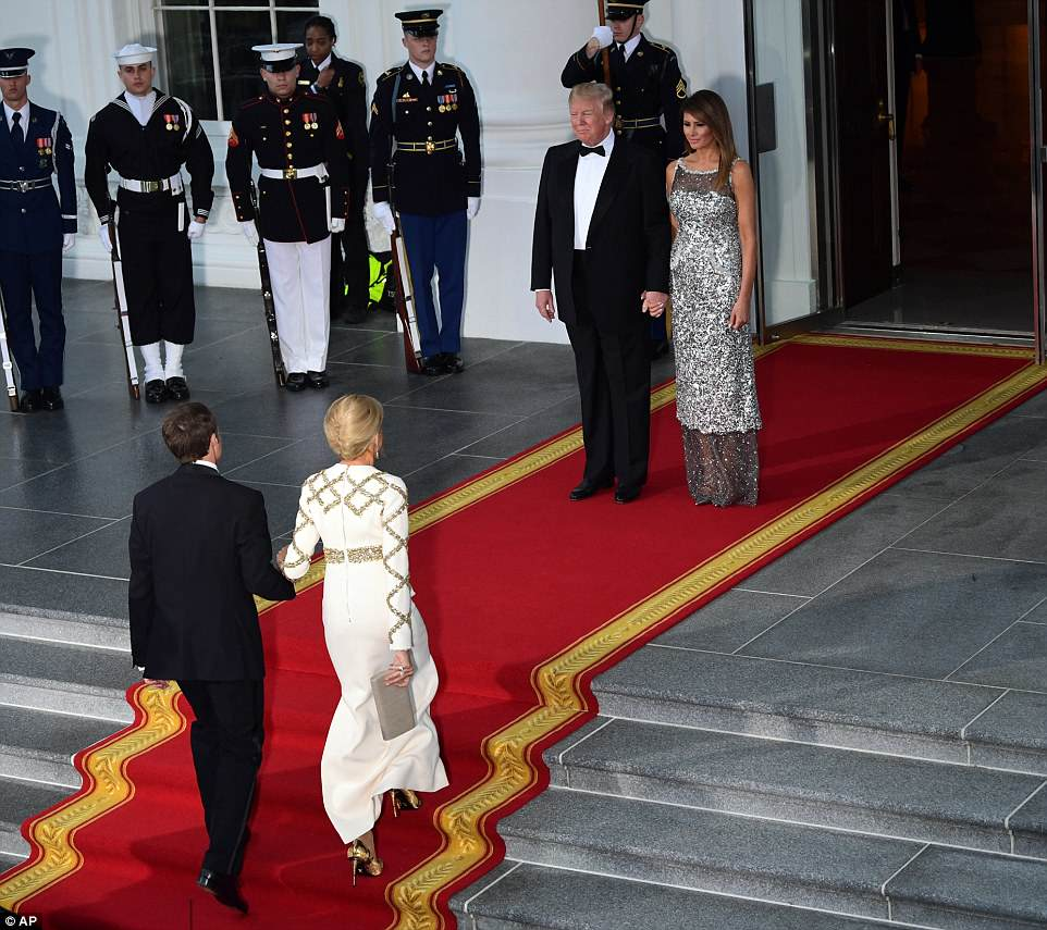 Macron and his wife Brigitte arrived at the White House as a light rain fell Tuesday evening